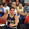 Legacy's Emiley Lopez dribbles the ball down court against Denver East's Michelle Cox during Friday's game at Denver East.<br /> March 1, 2013<br /> staff photo/ David R. Jennings