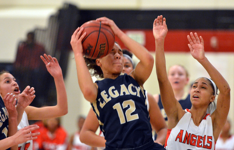Legacy's Mackenzie Neely rebounds the ball against Denver East during Friday's game at Denver East.<br /> March 1, 2013<br /> staff photo/ David R. Jennings