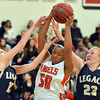 Legacy's Jenna Fenton, left, and Caitlyn Smith try to rebound the ball from Denver East's Khadijah Vigil during Friday's game at Denver East.<br /> March 1, 2013<br /> staff photo/ David R. Jennings