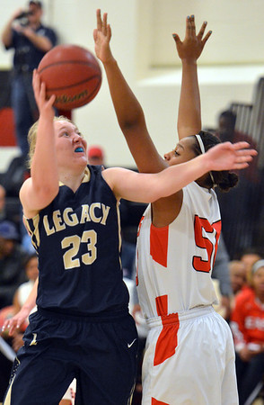 Legacy's Caitlyn Smith goes to the basket against Denver East's Khadijah Vigil during Friday's game at Denver East.<br /> March 1, 2013<br /> staff photo/ David R. Jennings