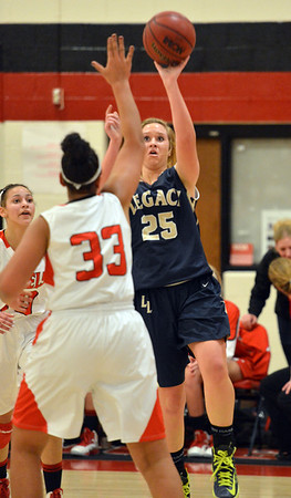 Legacy's Bree Paulson shoots the ball over Denver East's Francesca Sally during Friday's game at Denver East.<br /> March 1, 2013<br /> staff photo/ David R. Jennings