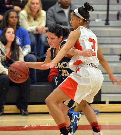 Legacy's Emiley Lopez dribbles the ball against Denver East's Michelle Cox during Friday's game at Denver East.<br /> March 1, 2013<br /> staff photo/ David R. Jennings
