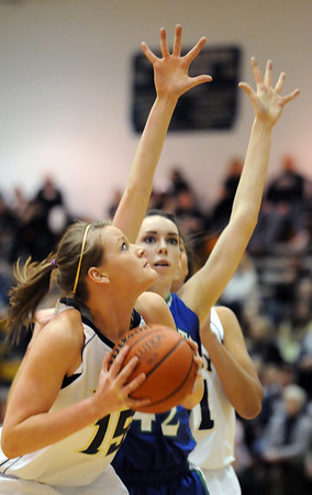 Legacy's Carli Moreland eyes the basket past Doherty's Kelsey English during Saturday's state 5A playoff game at Legacy.<br /> February 27, 2010<br /> Staff photo/David R. Jennings