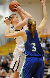 Legacy's Carli Moreland shoots to the basket against Doherty's Taylor Simpson during Saturday's state 5A playoff game at Legacy. February 27, 2010 Staff photo/David R. Jennings