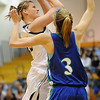 Legacy's Carli Moreland shoots to the basket against Doherty's Taylor Simpson during Saturday's state 5A playoff game at Legacy.<br /> February 27, 2010<br /> Staff photo/David R. Jennings