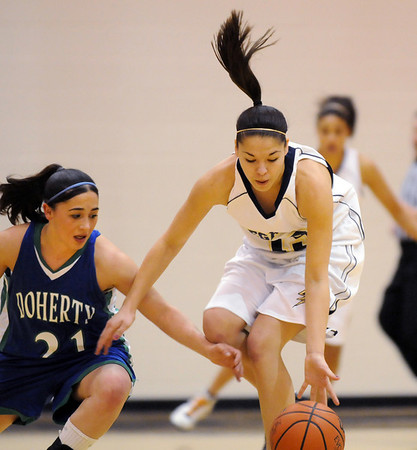 Legacy's Taylor Archuleta steals the ball from Doherty's Tasha Grimaldo during Saturday's state 5A playoff game at Legacy.<br /> February 27, 2010<br /> Staff photo/David R. Jennings