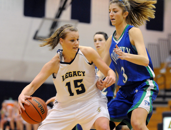 Legacy's Carli Moreland drives the ball past Doherty's Taylor Simpson during Saturday's state 5A playoff game at Legacy.<br /> February 27, 2010<br /> Staff photo/David R. Jennings