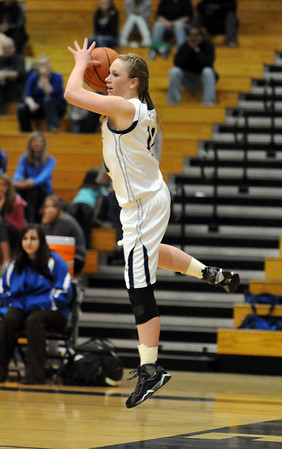 Legacy's Emily Glen passes the ball midair during play against Doherty in Saturday's state 5A playoff game at Legacy.<br /> February 27, 2010<br /> Staff photo/David R. Jennings