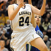 Legacy's Quincey Noonan goes to the basket against Doherty's Shalisa Moffit during Saturday's state 5A playoff game at Legacy.<br /> February 27, 2010<br /> Staff photo/David R. Jennings