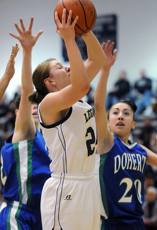 Legacy's Quincey Noonan goes to the basket against Doherty's Angela Vigil during Saturday's state 5A playoff game at Legacy.<br /> February 27, 2010<br /> Staff photo/David R. Jennings