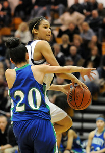 Legacy's Kailey Edwards goes to the basket against Doherty's Angela Vigil during Saturday's state 5A playoff game at Legacy. February 27, 2010 Staff photo/David R. Jennings
