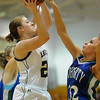 Legacy's Quincey Noonan shoots against Doherty's Shalisa Moffit during Saturday's state 5A playoff game at Legacy.<br /> February 27, 2010<br /> Staff photo/David R. Jennings