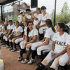 Legacy sits in the dugout because of lightning from a storm pausing the game against Erie during Friday's game at the Erie Festival of Champions softball tournament.<br /> <br /> September 2, 2011<br /> staff photo/ David R. Jennings