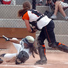 Legacy's Aspen Eubanks slides safely to home past Erie's catcher Makayla Kovac during Friday's game against Erie at the Erie Softball Tournament.<br /> <br /> September 2, 2011<br /> staff photo/ David R. Jennings