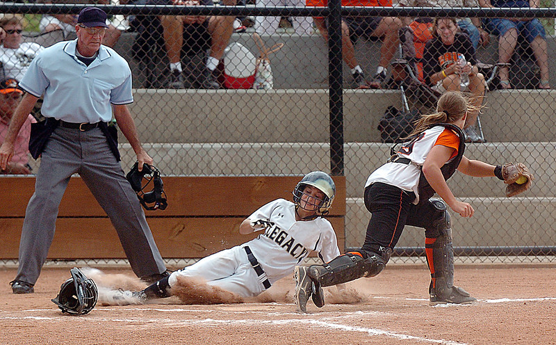 Legacy's Paige Reichmuth slides safely to home past Erie's catcher Makayla Kovac during Friday's game against Erie at the Erie Softball Tournament.<br /> <br /> <br /> September 2, 2011<br /> staff photo/ David R. Jennings