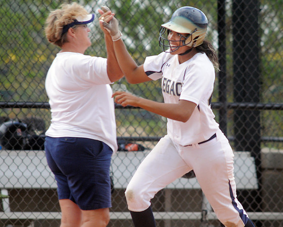 Legacy's Rainey Gaffin celebrates with her coach Dawn Gaffin after hitting a home run against Erie during Friday's game at the Erie Festival of Champions softball tournament.<br /> <br /> September 2, 2011<br /> staff photo/ David R. Jennings