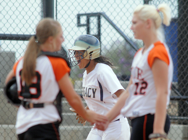 Legacy's Rainey Gaffin celebrates after hitting a home run while  Erie's cacher, Makayla Kovac and pitcher, Lauren Murphy-Payne consulte each other during Friday's game at the Erie Festival of Champions softball tournament.<br /> <br /> September 2, 2011<br /> staff photo/ David R. Jennings