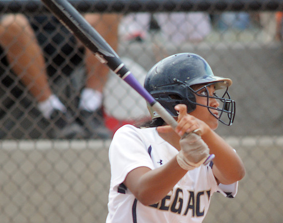 Legacy's Rainey Gaffin hits a home run against Erie during Friday's game at the Erie Festival of Champions softball tournament.<br /> <br /> <br /> September 2, 2011<br /> staff photo/ David R. Jennings