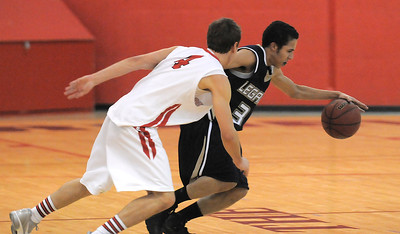 Legacy's Marcus Riddick drives the ball downcourt against Fairview's Holden Killeen during Thursday's game at Fairview. February 2, 2012 staff photo/ David R. Jennings