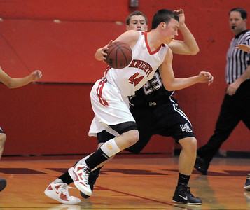 Fairview's Gibson Farone-Collins dribbles the ball around Legacy's Patrick Medina duringThursday's game at Fairview. February 2, 2012 staff photo/ David R. Jennings