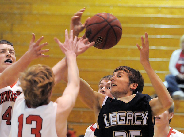 Legacy's Mitchell McCall  reaches to rebound the ball against Fairview during Thursday's game at Fairview.<br /> February 2, 2012<br /> staff photo/ David R. Jennings