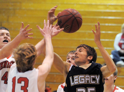 Legacy's Mitchell McCall  reaches to rebound the ball against Fairview during Thursday's game at Fairview. February 2, 2012 staff photo/ David R. Jennings