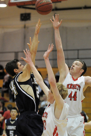 Legacy's Alec McLain shoots the ball over Fairview's Gibson Farone-Collins during Thursday's game at Fairview.<br /> February 2, 2012<br /> staff photo/ David R. Jennings