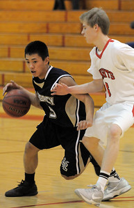 Legacy's Aaron Zhang drives the ball around Fairview's Brent Wrapp during Thursday's game at Fairview. February 2, 2012 staff photo/ David R. Jennings