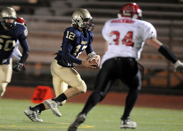Legacy's quarterback Zach Hart keeps the ball as he runs downfield against Fairview  during Friday's game at 5 Star Stadium in Thornton.<br /> <br /> October 9, 2009<br /> Staff photo/David R. Jennings
