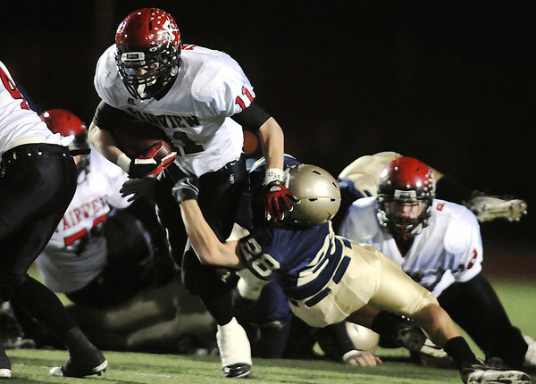 Fairview's Tucker Tharp is tackled by Legacy's Zach Wilson during Friday's game at 5 Star Stadium in Thornton.<br /> <br /> October 9, 2009<br /> Staff photo/David R. Jennings