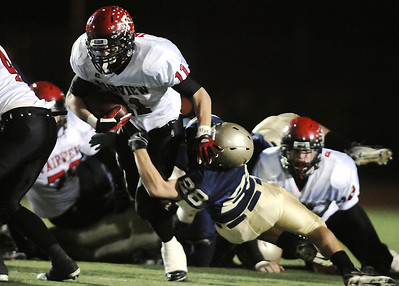 Fairview's Tucker Tharp is tackled by Legacy's Zach Wilson during Friday's game at 5 Star Stadium in Thornton.  October 9, 2009 Staff photo/David R. Jennings