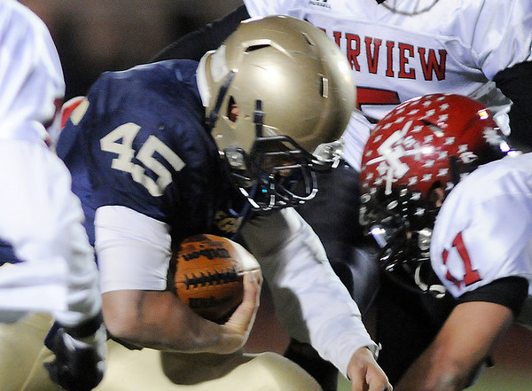 Colton Chavez, Legacy, goes head to head with Tucker Tharp, Fairview, during Friday's game at 5 Star Stadium in Thornton.<br /> <br /> October 9, 2009<br /> Staff photo/David R. Jennings