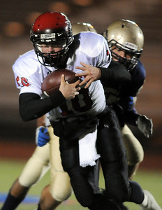 Fairview's Ben Schumacher takes the ball downfield against Legacy during Friday's game at 5 Star Stadium in Thornton.  October 9, 2009 Staff photo/David R. Jennings