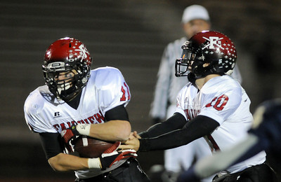 Fairview's quarterback Ben Schumacher hands off to Tucker Tharp during play against Legacy in Friday's game at 5 Star Stadium in Thornton.  October 9, 2009 Staff photo/David R. Jennings