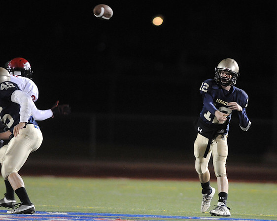 Legacy's quarterback Bradie Koch passes play against Fairview  during Friday's game at 5 Star Stadium in Thornton.<br /> <br /> October 9, 2009<br /> Staff photo/David R. Jennings