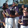 Legacy's Jessica Ball, right, celebrates with Rainey Gaffin after Ball hit a home run against Fruita Monument during the state softball tournament at the Aurora Sparts Park on Friday.<br /> October 21, 2011<br /> staff photo/ David R. Jennings