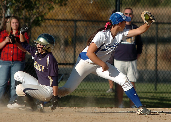 Legacy's Paige Reichmuth slides to third base past Fruita Monument's Mallory Paulson during the state softball tournament at the Aurora Sparts Park on Friday.<br /> October 21, 2011<br /> staff photo/ David R. Jennings