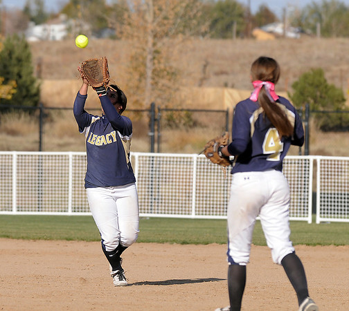 Legacy's Jessica Ball catches a Fruita Monument flyball with teammate Paige Reichmuth standing by during the state softball tournament at the Aurora Sparts Park on Friday.<br /> October 21, 2011<br /> staff photo/ David R. Jennings