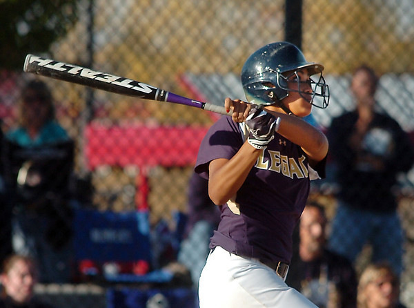 Legacy's Rainey Gaffin hits a home run against Fruita Monument during the state softball tournament at the Aurora Sparts Park on Friday.<br /> October 21, 2011<br /> staff photo/ David R. Jennings