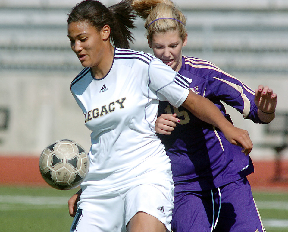 be0410legsoccer06<br /> Sade Akindele, Legacy, keeps control of the ball from Zoey Weappa, Ft. Collins during Thursday's game at North Stadium.<br /> April 7, 2011<br /> staff photo/David R. Jennings