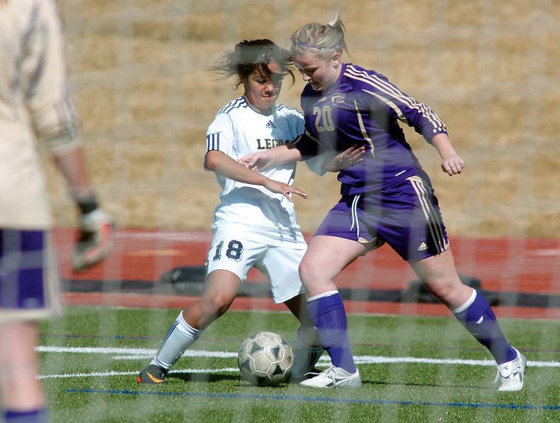 be0410legsoccer04<br /> Brianda Quinones, Legacy, fights for control of the ball near the goal with Lexie Deeter, Ft. Collins during Thursday's game at North Stadium.<br /> April 7, 2011<br /> staff photo/David R. Jennings