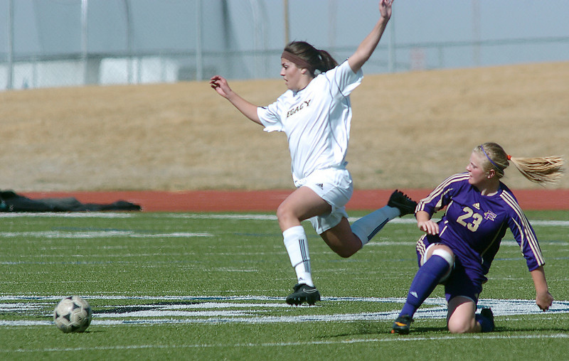be0410legsoccer05<br /> Taylor Hunter, Legacy, runs after the ball past Katy Couperus, Ft. Collins during Thursday's game at North Stadium.<br /> April 7, 2011<br /> staff photo/David R. Jennings