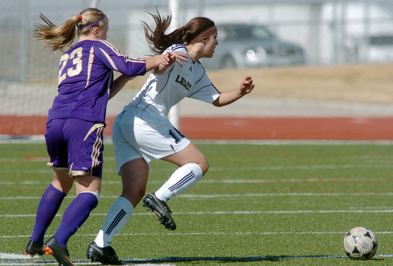 be0410legsoccer03<br /> Taylor Hunter, Legacy, fights for control of the ball against Katy Couperus, Ft. Collins during Thursday's game at North Stadium.<br /> April 7, 2011<br /> staff photo/David R. Jennings
