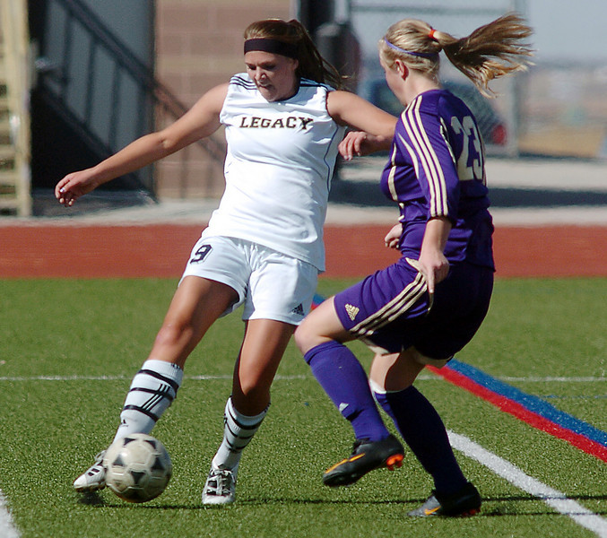be0410legsoccer11<br /> Regan Pratt, Legacy, takes control of the ball from Katy Couperus, Ft. Collins during Thursday's game at North Stadium.<br /> April 7, 2011<br /> staff photo/David R. Jennings
