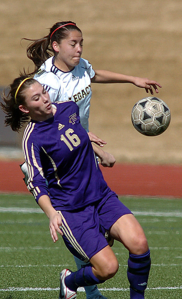 be0410legsoccer08<br /> Taylor Archuleta, Legacy, fights for control of the ball against Nicole Mullen, Ft. Collins during Thursday's game at North Stadium.<br /> April 7, 2011<br /> staff photo/David R. Jennings