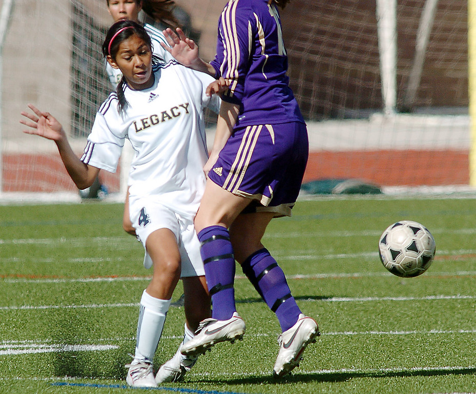 be0410legsoccer09<br /> Jessie Parra, Legacy, moves the ball around Nicole Mullen, Ft. Collins during Thursday's game at North Stadium.<br /> April 7, 2011<br /> staff photo/David R. Jennings