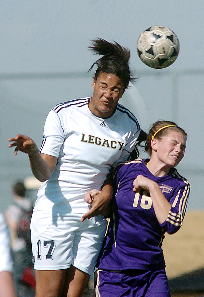be0410legsoccer07<br /> Sade Akindele, Legacy, moves the ball with a header against Nicole Mullen, Ft. Collins during Thursday's game at North Stadium.<br /> April 7, 2011<br /> staff photo/David R. Jennings
