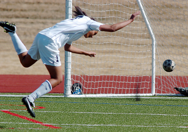 be0410legsoccer02<br /> Sade Akindele, Legacy, flies in the air to score her second goal against Ft. Collins during Thursday's game at North Stadium.<br /> April 7, 2011<br /> staff photo/David R. Jennings