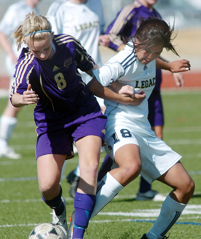 be0410legsoccer12<br /> Legacy's Brianda Quinones fights for control of the ball with Morgan Reuter, Ft. Collins during Thursday's game at North Stadium.<br /> April 7, 2011<br /> staff photo/David R. Jennings