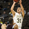 Jade Roberts, Legacy, shoots for two over Horizon's Jesse Torrez during Wednesday's game at the Pepsi Center in Denver.<br /> <br /> <br /> January 13, 2010<br /> Staff photo/David R. Jennings
